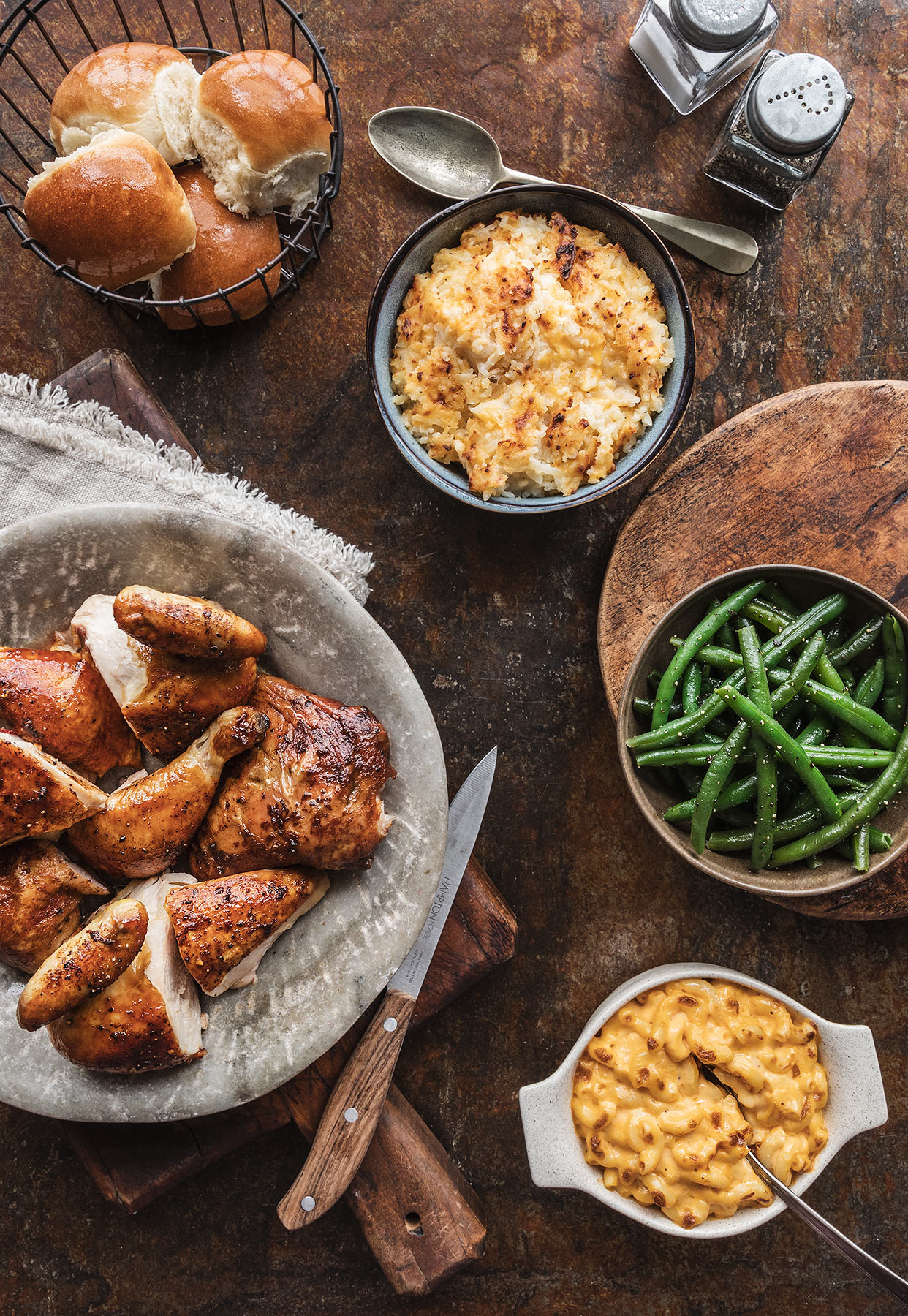 Family dinner. Rotisserie chicken, potato, green beans, mac & cheese