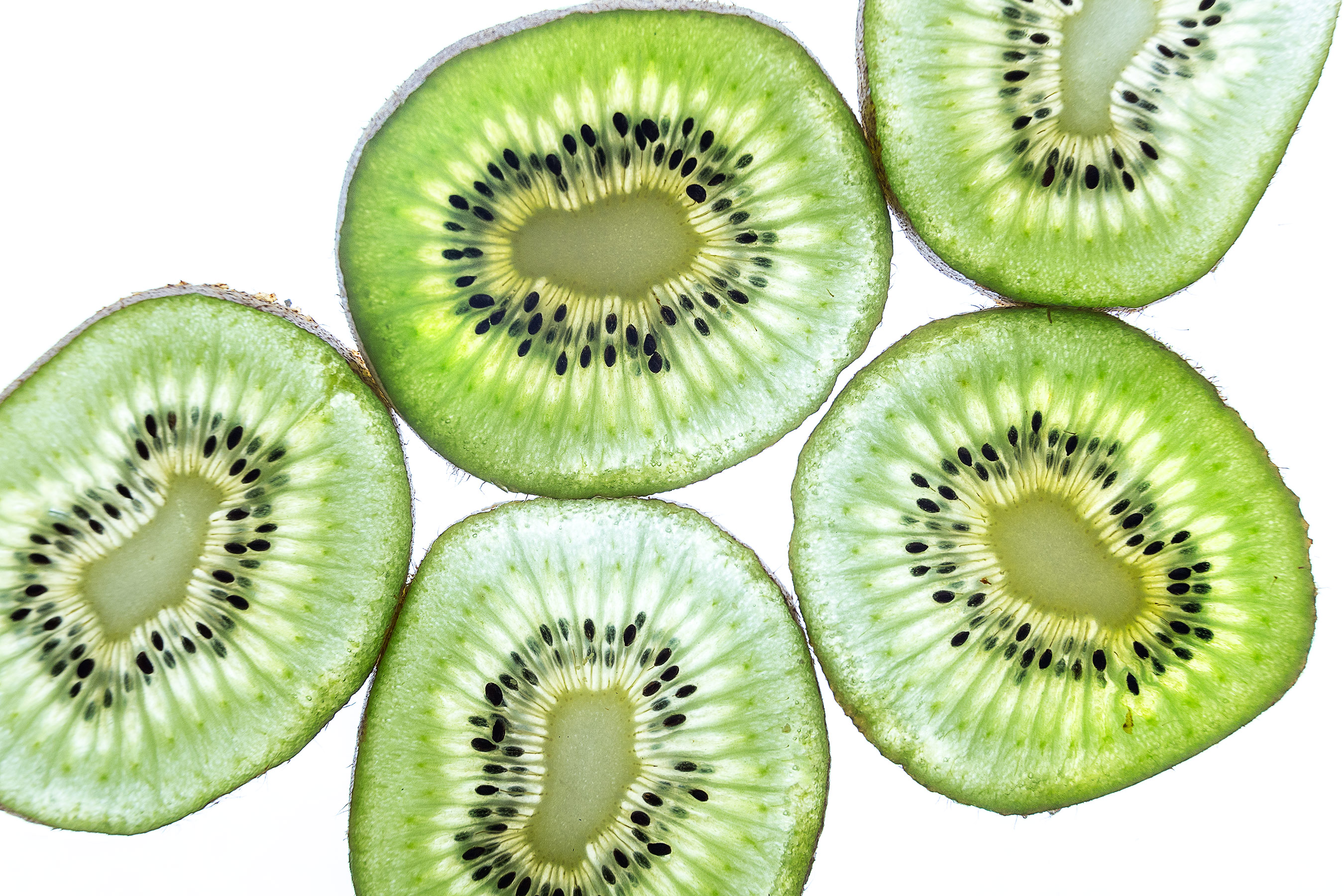 5 backlit slices of Kiwi