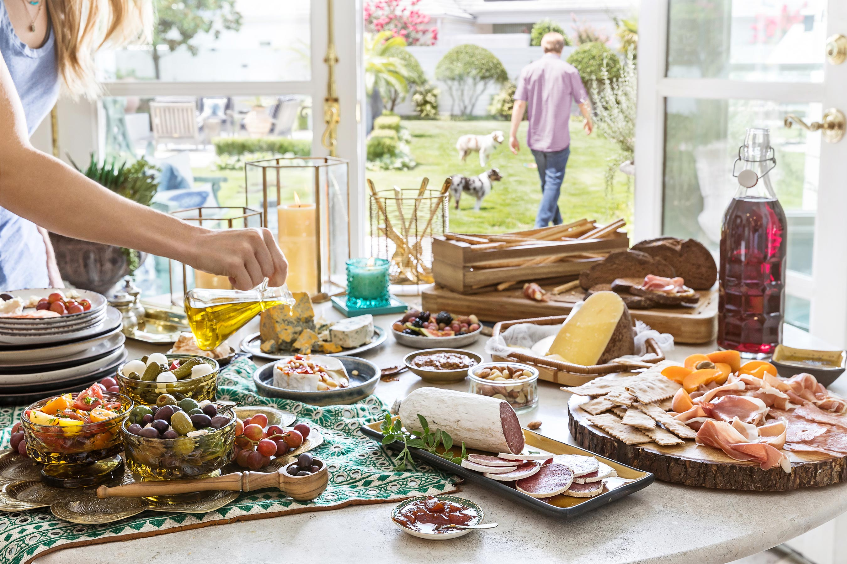 Huge spread of Mediterranean food, cheeses and charcuterie on a table