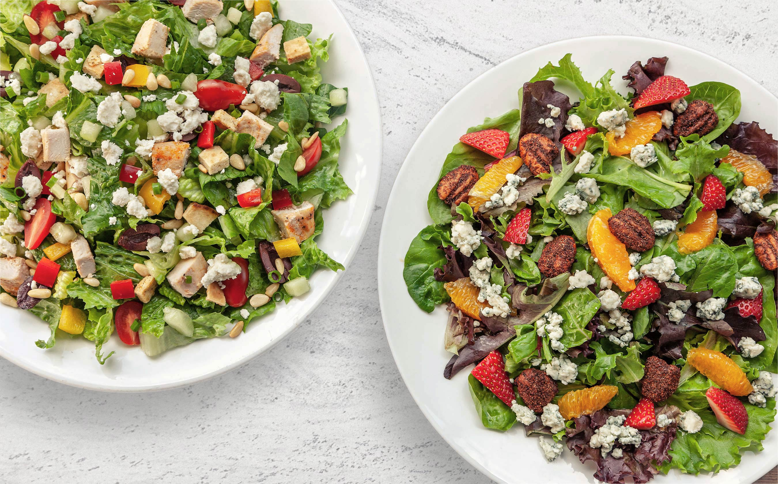 2 Salads w/ chicken, Feta, mandarin, strawberries, olives, pine nuts…