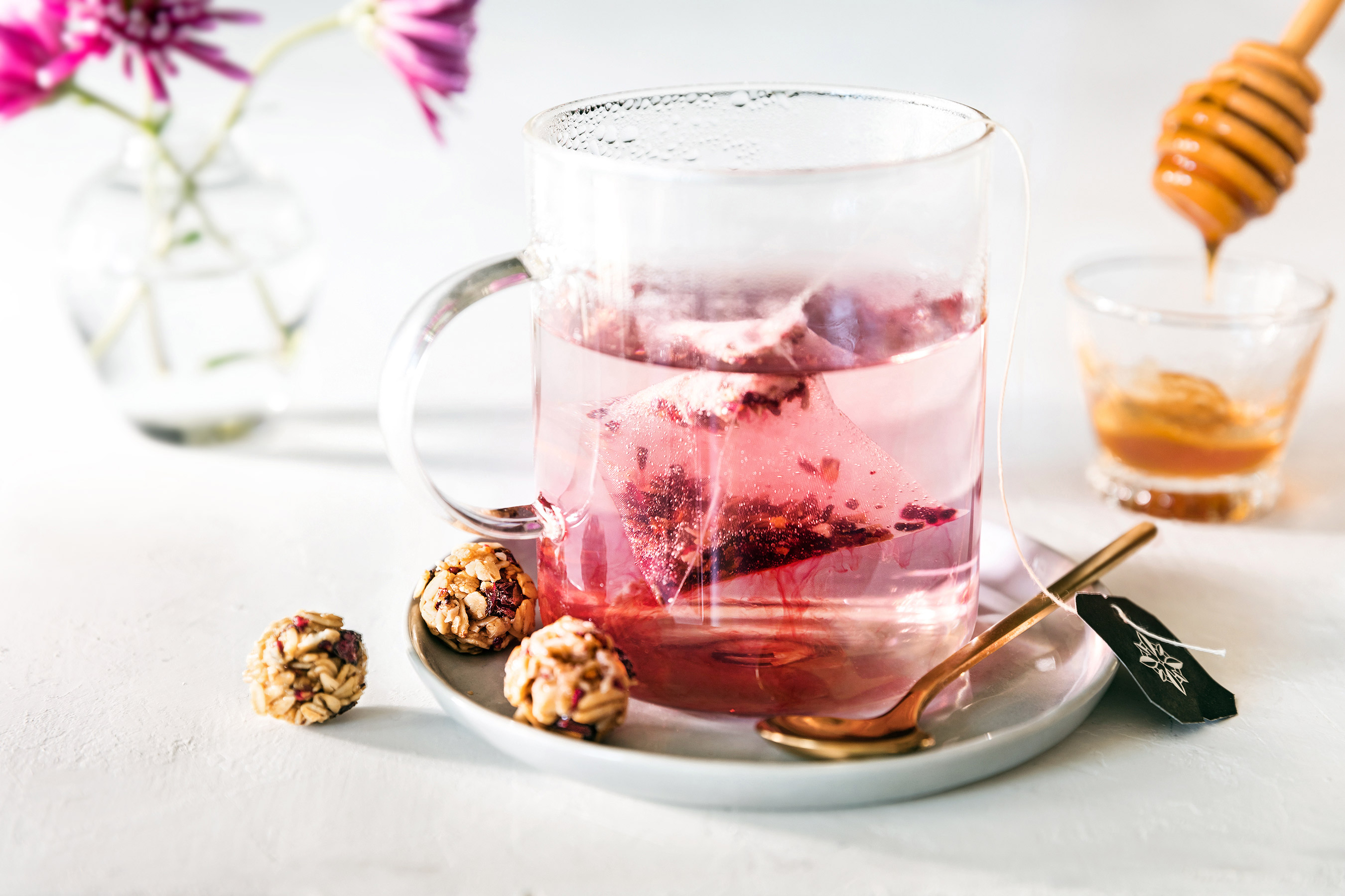 Glass of Herbal Tea with Granola Bites and honey